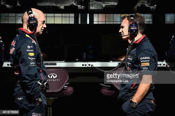 Infiniti Red Bull Racing Team Principal Christian Horner speaks with Adrian Newey the Infiniti Red Bull Racing Chief Technical Officer during...