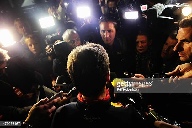 Infiniti Red Bull Racing Team Principal Christian Horner talks to the media after his driver Daniel Ricciardo who finished second was excluded from...