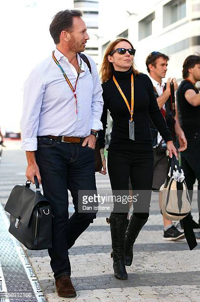 Infiniti Red Bull Racing Team Principal Christian Horner walks through the paddock with Geri Halliwell during previews ahead of the Russian Formula...