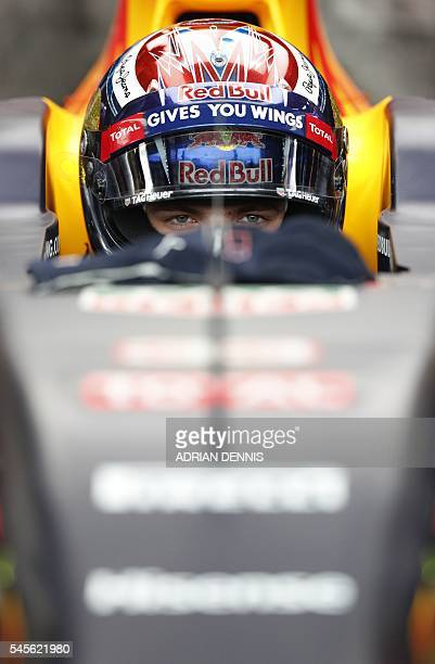 TOPSHOT Infiniti Red Bull racing's BelgianDutch driver Max Verstappen sits in his car as he waits to leave the pits during the third practice session...