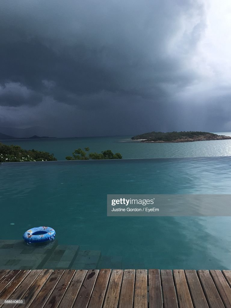 Infinity Pool Against Cloudy Sky : Stock Photo