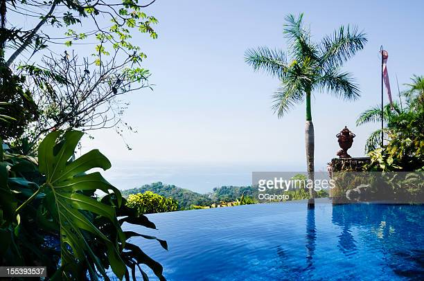 infinity pool looking out to the pacific ocean - guanacaste stock pictures, royalty-free photos & images