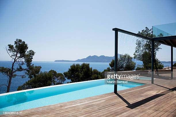 infinity pool outside modern house - majorca stock pictures, royalty-free photos & images