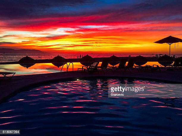 Infinity pool with colorful sunset in Puerto Vallarta, Mexico