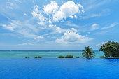 infinity swimming pool tropical beach