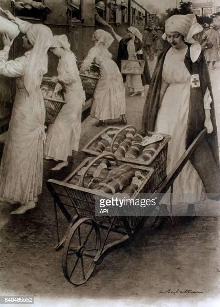 Infirmières distribuant du pain aux soldats français sur le quai d'une gare pendant la Première Guerre mondiale en 1916 France