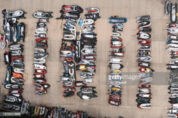 Inflatable dinghies used by migrants to cross the channel from France are stored in a compound on June 11, 2021 in Dover, England. More than 500...