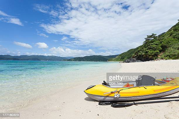 Inflatable kayak on deserted tropical beach, Japan