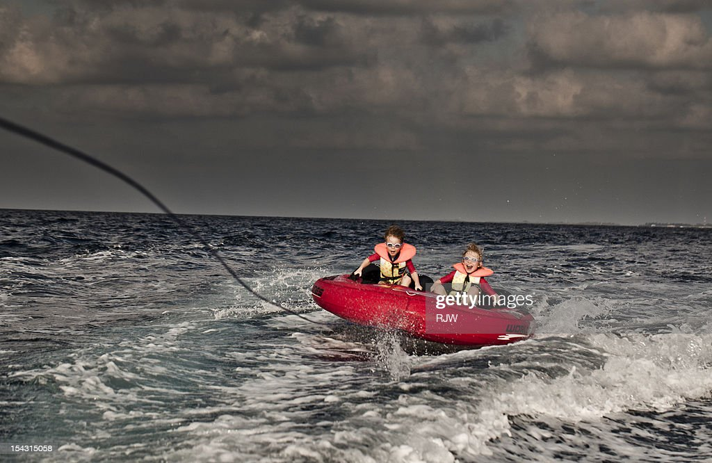 Inflatable on back of speed boat : Stock Photo