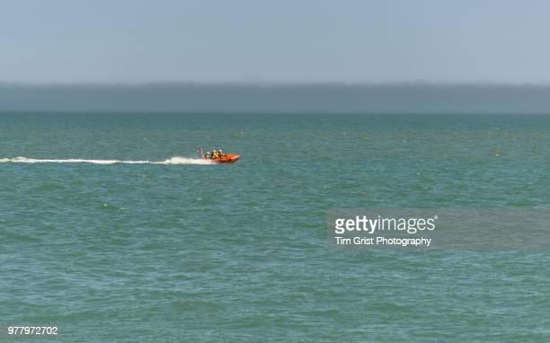 Inflatable Orange RNLI Life Boat at Full Speed