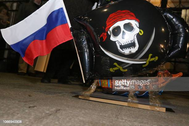 Inflatable Pirate ship with Russian flag is seen in front of Russian Federation consulate in Gdansk Poland on 30 November 2018 People protest against...