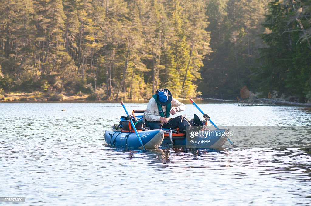 Inflatable Pontoon Boat With Man Trout Fishing On Cleawox