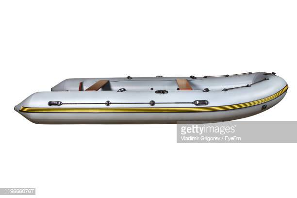 inflatable raft against white background - inflatable raft stock pictures, royalty-free photos & images
