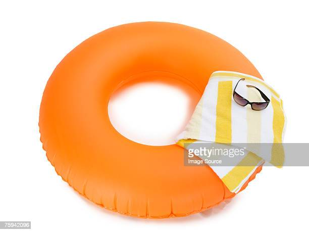 Inflatable ring beach towel and sunglasses