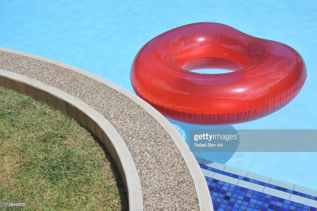 Inflatable ring floating in a swimming pool : Stock Photo