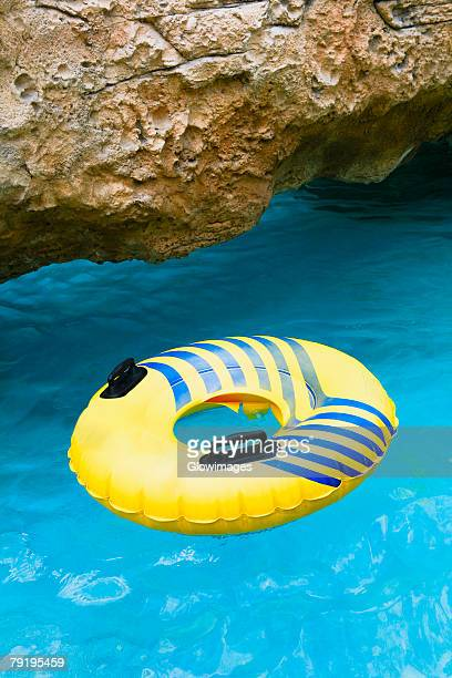 inflatable ring floating on water, cable beach, nassau, bahamas - cable beach bahamas stock photos and pictures