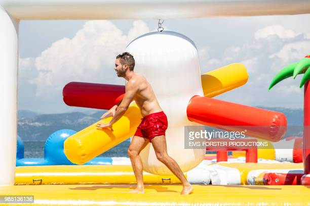inflatable rubber water fun park in corfu / greece - obstacle course stock photos and pictures