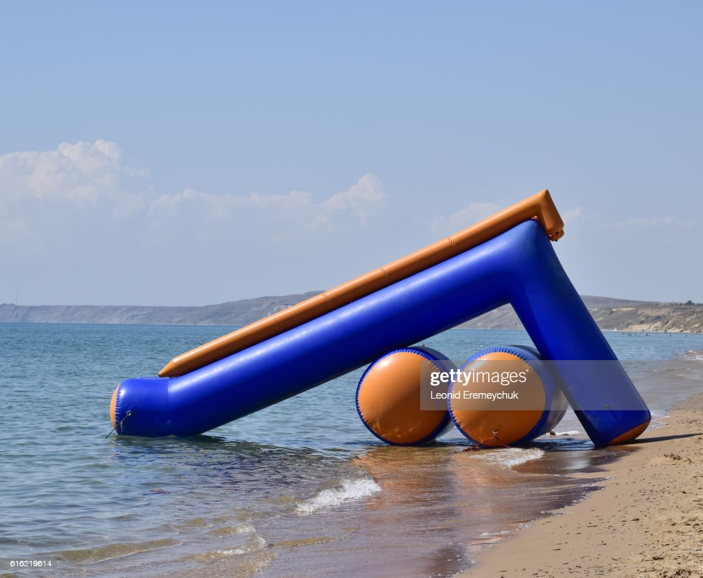 Inflatable slides to slide into the water : Stock Photo
