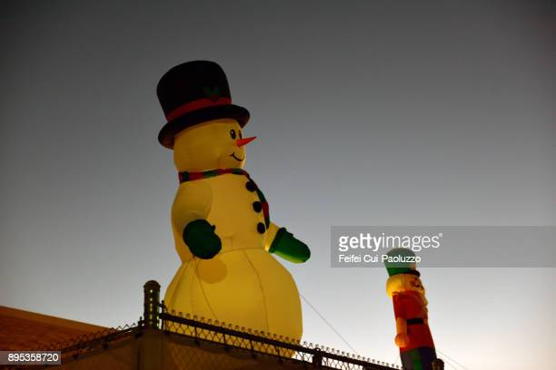 Inflatable snowman on the roof at Alamogordo, New Mexico, USA