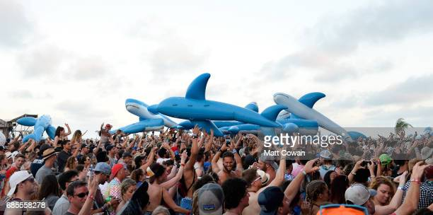 Inflatable whales crowd surf over festivalgoers as MGMT performs at the Hangout Stage during 2017 Hangout Music Festival on May 19 2017 in Gulf...