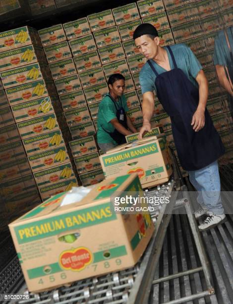 InflationpovertyfoodPhilippinesagriculturereformFEATURE by Cecil Morella Boxes of freshly harvested Philippine bananas destined for Oman are loaded...