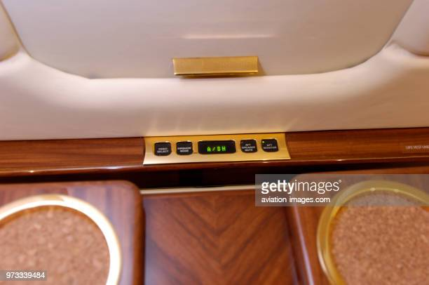 inflight entertainment controls on the table in the passenger cabin of a London Executive Aviation LEA Bombardier Challenger 604
