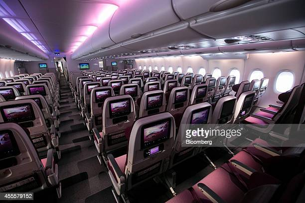 Inflight entertainment monitors sit on economy class seats inside Qatar Airways Ltd's first Airbus A380 at the Airbus Group NV factory in Hamburg...
