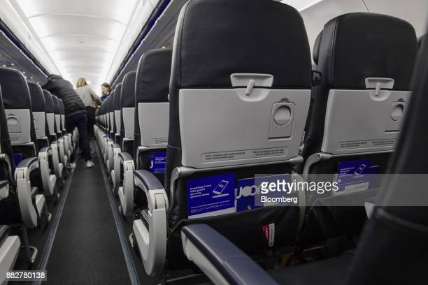 Inflight information literature sits in passenger seating onboard a Joon passenger jet the new lowcost carrier operated by Air FranceKLM Group at...
