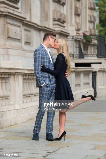 Influencer and model Angus Findlay wears a Marc Darcy suit, and waistcoat, Ralph Lauren shirt, Lasocki shoes and Dior glasses with model and...