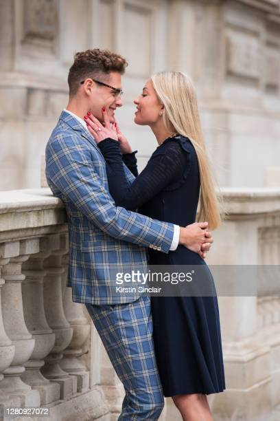 Influencer and model Angus Findlay wears a Marc Darcy suit, Ralph Lauren shirt and Dior glasses with model and Influencer Lexi Fargo wearing a Chanel...