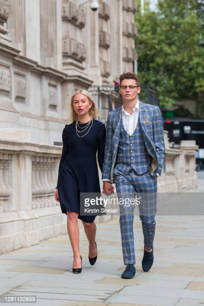 Influencer and model Lexi Fargo wears a Chanel dress with Model and Influencer Angus Findlay wearing a Marc Darcy suit, and waistcoat, Ralph Lauren...