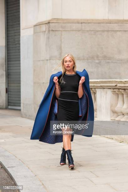 Influencer and model Lexi Fargo wears a Louis Vuitton coat, Orsay dress, Dior runway collection boots and Chanel earrings during LFW September 2020...