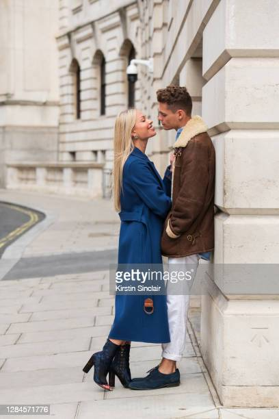Influencer and model Lexi Fargo wears a Louis Vuitton coat, Orsay dress, runway Dior boots and Chanel earrings with Model and Influencer Angus...
