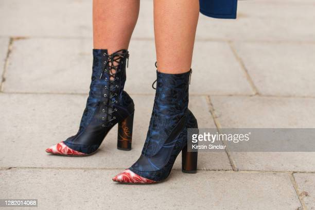 Influencer and model Lexi Fargo wears Dior runway collection boots during LFW September 2020 at on September 21, 2020 in London, England.