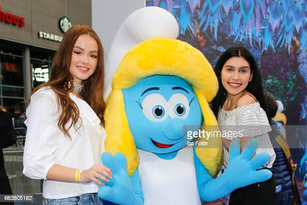 Influencer and youtubestar Ana Lisa Kohler and model Soraya Eckes with smurf 'Schlumpfine' during the 'Die Schluempfe Das verlorene Dorf' premiere at...