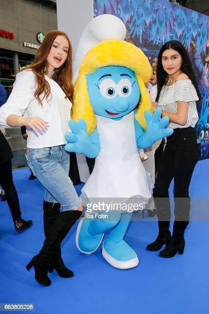 Influencer and youtubestar Ana Lisa Kohler and model Soraya Eckes with smurf 'Schlumpfine' during the 'Die Schluempfe Das verlorene Dorf' premiere at...