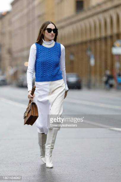 Influencer Annette Weber wearing a beige and white midi length skirt by Baum und Pferdgarten, a white turtleneck pullover by Wolford, a blue knitted...