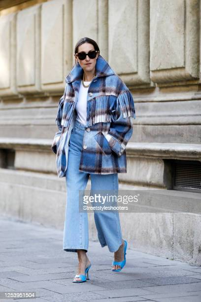 Influencer Annette Weber wearing a blue checked Jacket with fringes by Asos a blue Jeans by Iris and Ink blue mules by Mango and sunglasses by...