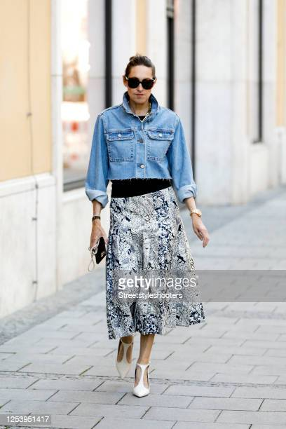 Influencer Annette Weber wearing a Jeans Jacket by Asos, a white-blue skirt with flower print by Sportmax, white sandals by Mx Mara and sunglasses by...