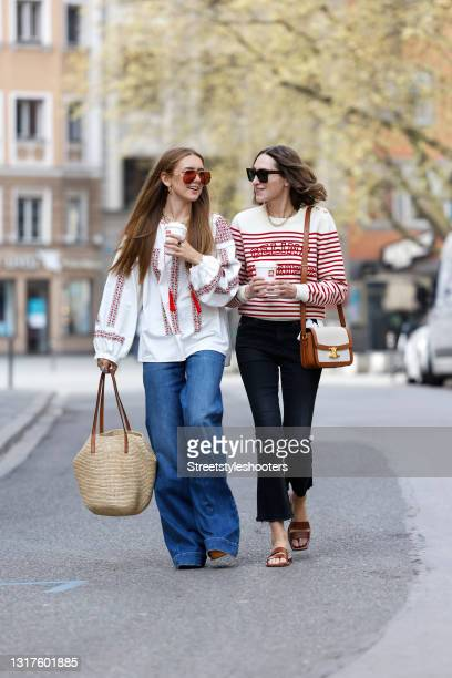 Influencer Annette Weber wearing a white and red striped pullover with front print by Celine, black denim jeans pants by Adriano Goldschmied, brown...