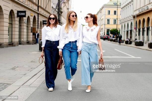 Influencer Annette Weber wearing a white blouse by Seidensticker, a denim jeans by Levis and a light brown bag by Jimmy Choo, influencer Alex...