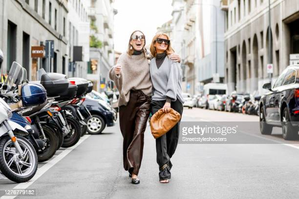 Influencer Annette Weber wearing brown leather pants and a camel colored pullover by Brunello Cucinelli, black slippers by Bally and sunglasses by...