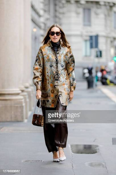 Influencer Annette Weber, wearing brown leather pants by Brunello Cucinelli, a gold colored Tunic with floral pattern by Etro, white pimps by Fendi,...