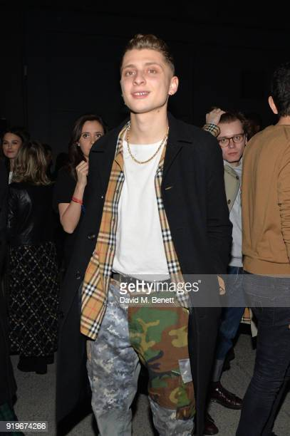 Influencer Blondey McCoy wearing Burberry at the Burberry February 2018 show during London Fashion Week at Dimco Buildings on February 17 2018 in...