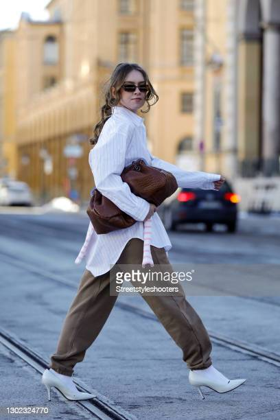 Influencer Brianna Beckwith wearing a white shirt with black pinstripes by Seidensticker, a white and pink striped shirt by Glam-O-Meter, brown pants...
