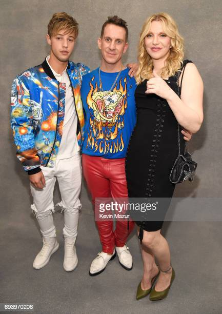 Influencer Cameron Dallas designer Jeremy Scott and Courtney Love pose backstage at Moschino Spring/Summer 18 Menswear and Women's Resort Collection...