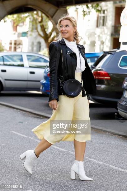 Influencer Carina Grendel , wearing a black leather jacket by Benedetta Novi, a white blouse with lace embroidery by Zara, a yellow silk skirt by...