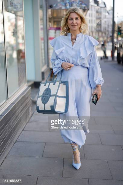 Influencer Carina Grendel wearing a light blue blouse by Forte Forte, a long light blue maxi skirt by Forte Forte, light blue pumps by Zara,...