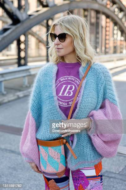 Influencer Carina Grendel wearing sunglasses by Saint Laurent, a purple shirt by Liv Bergen, a pastel blue and salmon colored bucket bag by Pucci and...