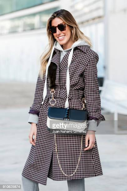 Influencer Carla Hinojosa wears Rucoline sneakers Etro coat and Valentino handbag and Chloe sunglasses during Mercedes Benz Fashion Week Madrid...